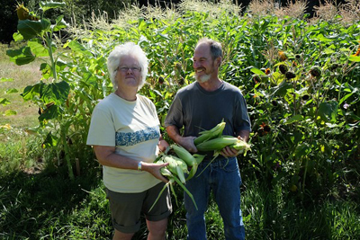 Two farmers with corn