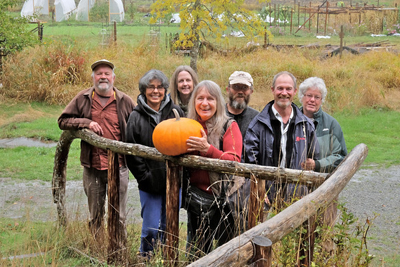 Farmers posed with a pumpkin