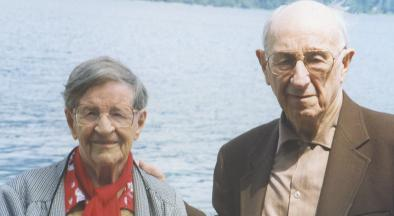 Owen and Elsie Williams in front of a lake.
