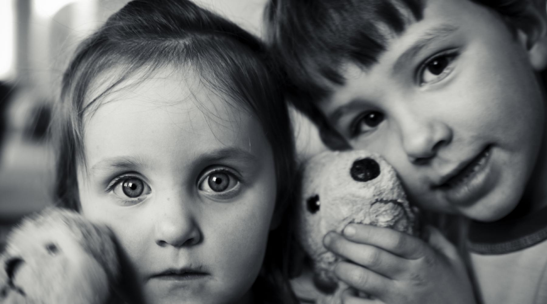 Kids with their stuffed animals.